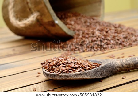 flax seed on wooden table