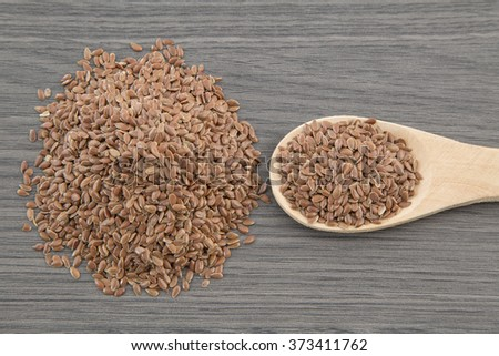 Flax seeds close up on a wooden spoon on a table. horizontal