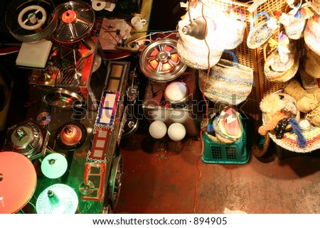 Flea Market Merchandise Including Lamps made from Hubcaps - stock photo