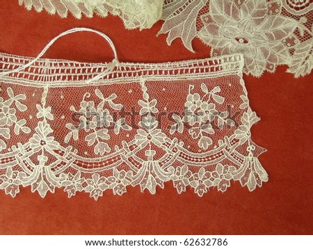 Flemish lace from Belgian Flanders (Bruges area) isolated over red background