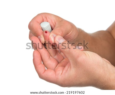 Flesh blood wound from diabetes patient finger to make glucose level blood test isolated on a white background - stock photo