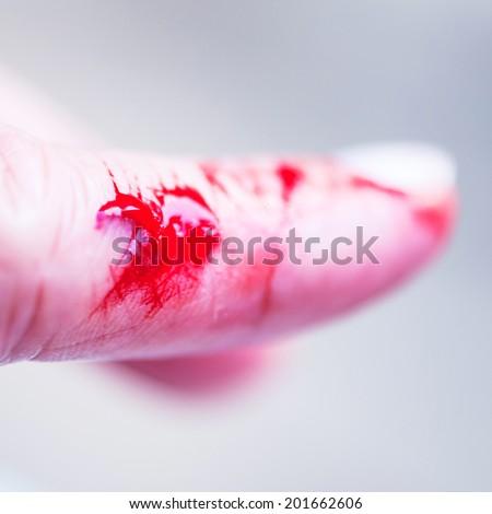 flesh wound closeup - blood finger - stock photo