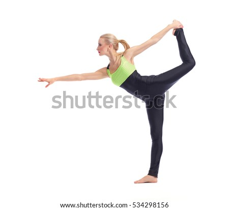 Flexible body. Full length shot of a fit young woman doing yoga against white background balancing on one leg posing gracefully copyspace