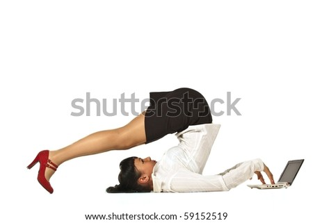 Flexible businesswoman with laptop computer over white background