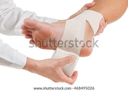 Flexible elastic supportive orthopedic bandage with white background, compression stabilizer ankle.