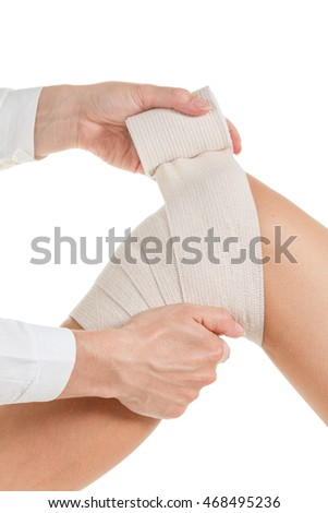 Flexible elastic supportive orthopedic bandage with white background, compression stabilizer knee.