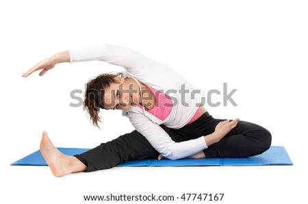 flexible young woman stretching body isolated on white - stock photo