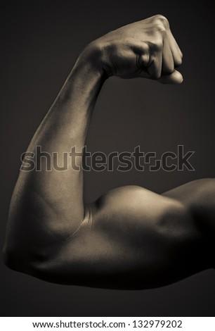 Flexing Biceps - stock photo