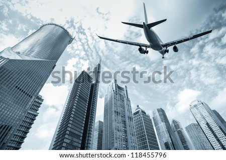 flight and modern buildings in shanghai lujiazui finance and trade zone - stock photo