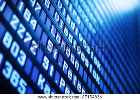 Flight arrival and departure board in airport, closeup. Abstract background. - stock photo