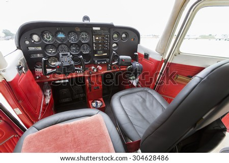 Flight desk control panel on a two-seated old small airplane. - stock photo
