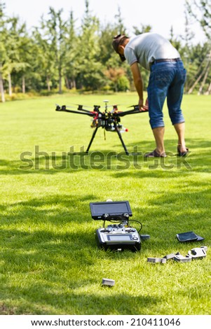 Flight enthusiasts debugging UAV Octocopter in Park   - stock photo