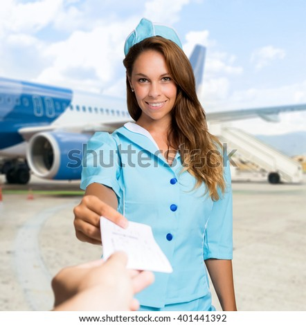 Flight hostess checking a ticket
