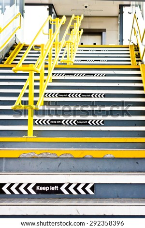 Flight of stairs in a UK train station with signs to keep left - stock photo