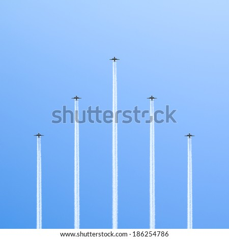 Flight of the five planes in the sky. - stock photo