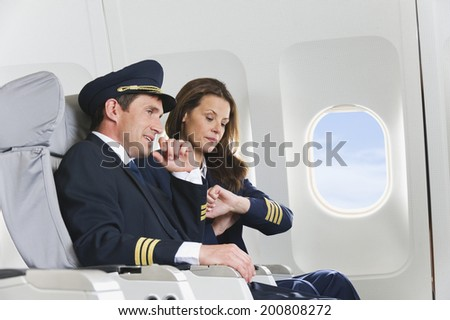 Flight personnel on airplane