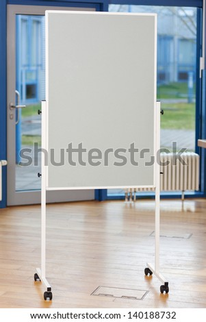 Flip chart on hardwood floor in boardroom - stock photo