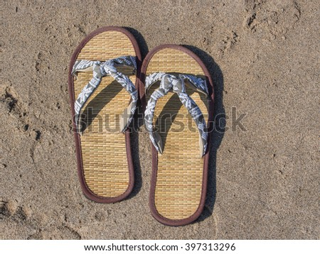 Flip-flops are a type of open-toed footwear sandal, typically worn as a form of casual wear. - stock photo
