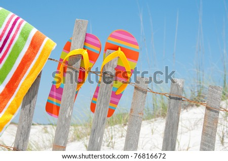 flip flops hanging on fence - stock photo