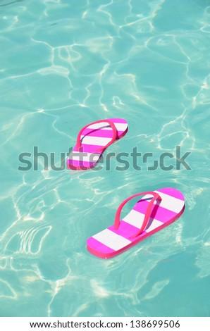 Flip-flops in water - stock photo