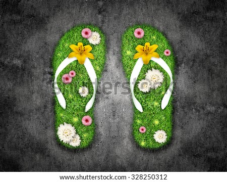 Flip-flops made of grass. Beach slippers with a grass. Two sandals with green grass and some flowers.