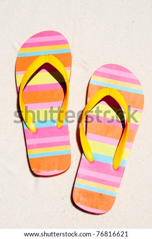 flip flops on beach sand - stock photo