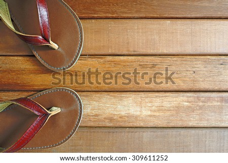 Flip flops on old wooden background with copy space. Top view. - stock photo