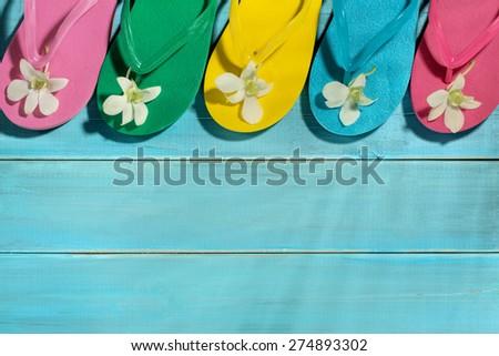 Flip-flops on wooden board - stock photo