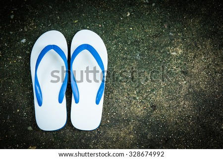 flip flops slippers on old concrete background. - stock photo
