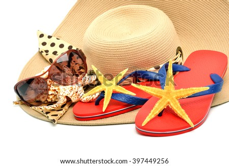 Flip flops with starfishes, sunglasses and seashell isolated on white. - stock photo
