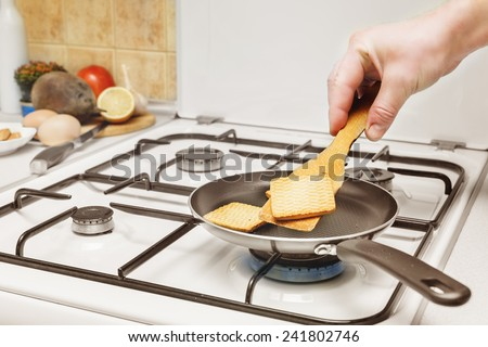 flip fried in a skillet toast burning flame