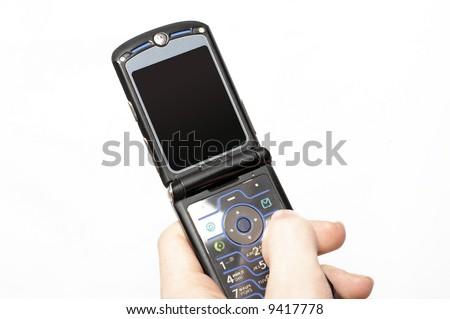 Flip mobile phone in hand - stock photo