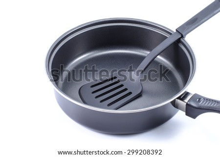 Flipper used in frying on pan isolated on white background