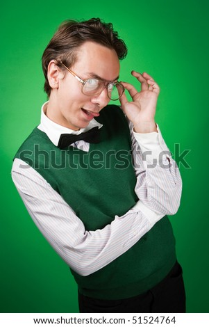 Flirting nerd is trying to look sexy but making a stupid face - stock photo