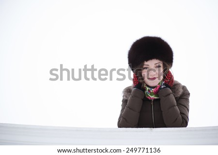 Flirting young brunette in love leaned on the fence - stock photo