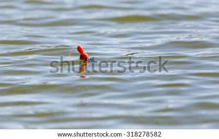 float for fishing on the surface of the water - stock photo