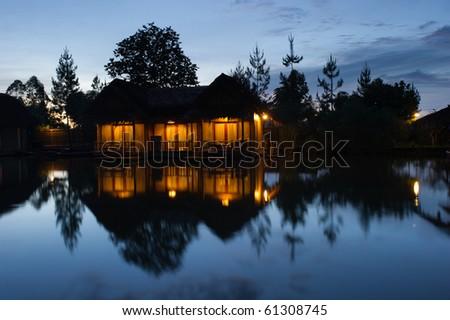 floating bamboo hut early morning - stock photo