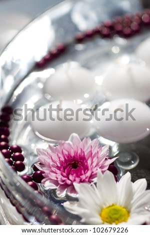 Floating Candles and Flowers. Decoration for a garden party - stock photo