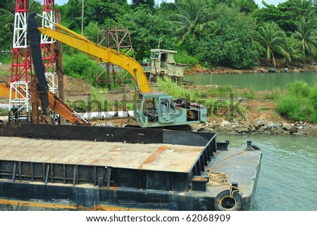 Floating crane dredging at Chang Islands - stock photo