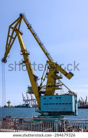Floating crane in sea port, Odessa, Ukraine - stock photo