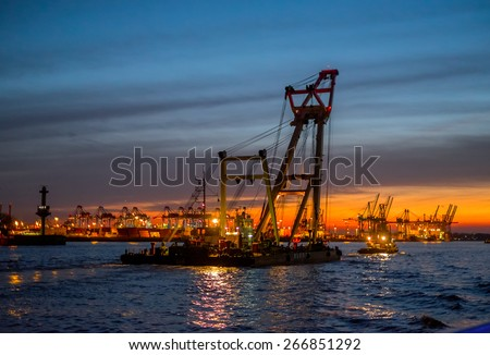 Floating crane in the Hamburg port at the night - stock photo