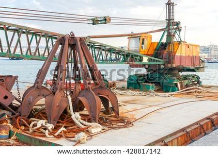 Floating crane on the barge. - stock photo