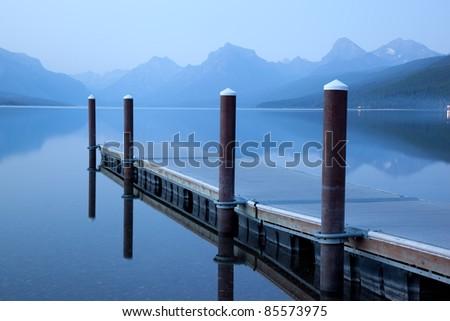 Floating Dock on Serene Lake (Lake McDonald, Glacier National Park) - stock photo