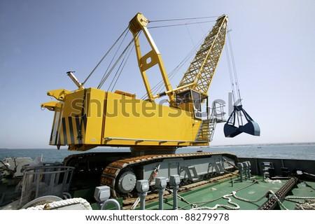 Floating dredging platform on the sea - stock photo
