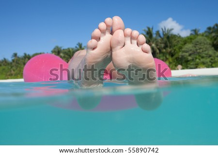 Floating feet in the sunshine - stock photo