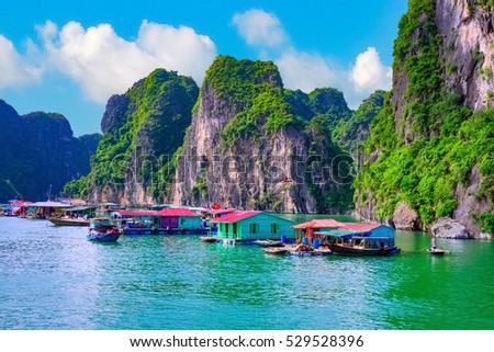 Floating fishing village rock island in Halong Bay Vietnam, Southeast Asia. UNESCO World Heritage Site. Junk boat cruise to Ha Long Bay. Landscape. Popular asian landmark famous destination of Vietnam