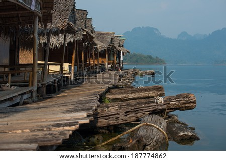 Floating house at Rachapapha dam. Khao Sok National Park. Thailand. - stock photo