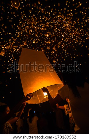 Floating lantern in Yee Peng festival, Buddhist floating lanterns to the Buddha in Sansai district, Chiang Mai, Thailand - stock photo