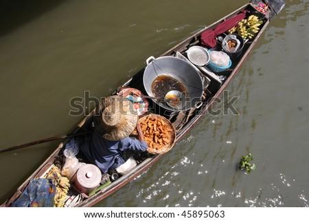 Floating Market in Thailand. Damnoen Saduak near Bangkok. - stock photo