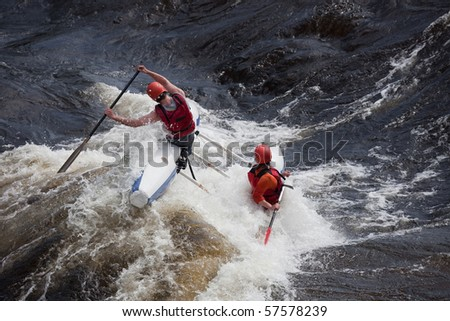 Floating raft on big wave of stormy river.